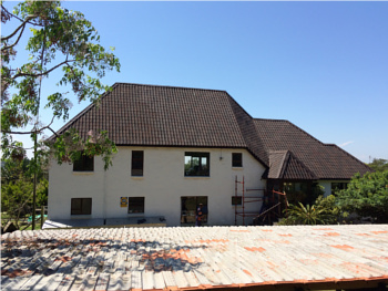 Thatch roof converted to onduvilla tiles